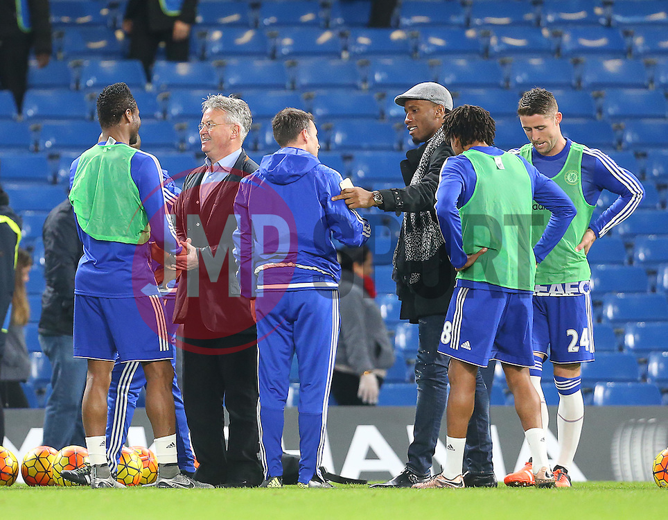 Newly appointed Chelsea Manager, Guus Hiddink ( 2nd L ),  and Didier Drogba (  3rd R ) shake hands with the players after the match  - Mandatory byline: Paul Terry/JMP - 07966 386802 - 19/12/2015 - FOOTBALL - Stamford Bridge - London, England - Chelsea v Sunderland - Barclays Premier League