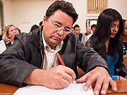 19 DECEMBER 2010 - PHOENIX, AZ:  TOMAS AMAYA signs a pledge to support the DREAM Act at a prayer service in Phoenix. About 100 supporters of the DREAM Act gathered at First Congregational Church of Christ in Phoenix Sunday night, December 19, for a prayer vigil in support of the DREAM Act, which was defeated in the US Senate Saturday, Dec. 18. The DREAM Act, was supported by the Obama administration, and was an important part of the administration's immigration reform platform. The defeat of the DREAM Act, which would have established a path to citizenship for undocumented immigrants who were brought to the US by their parents when they were children, set back the President's immigration reform efforts.    PHOTO BY JACK KURTZ