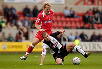 Photo: Leigh Quinnell.<br /> Swindon Town v Grimsby Town. Coca Cola League 2. 14/10/2006. Swindons Royce Brownlie tangles with Grimsbys Gary Croft.