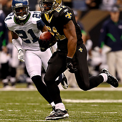 November 21, 2010; New Orleans, LA, USA; New Orleans Saints running back Julius Jones(21) runs past Seattle Seahawks cornerback Kelly Jennings (21)during the second half at the Louisiana Superdome. The Saints defeated the Seahawks 34-19. Mandatory Credit: Derick E. Hingle