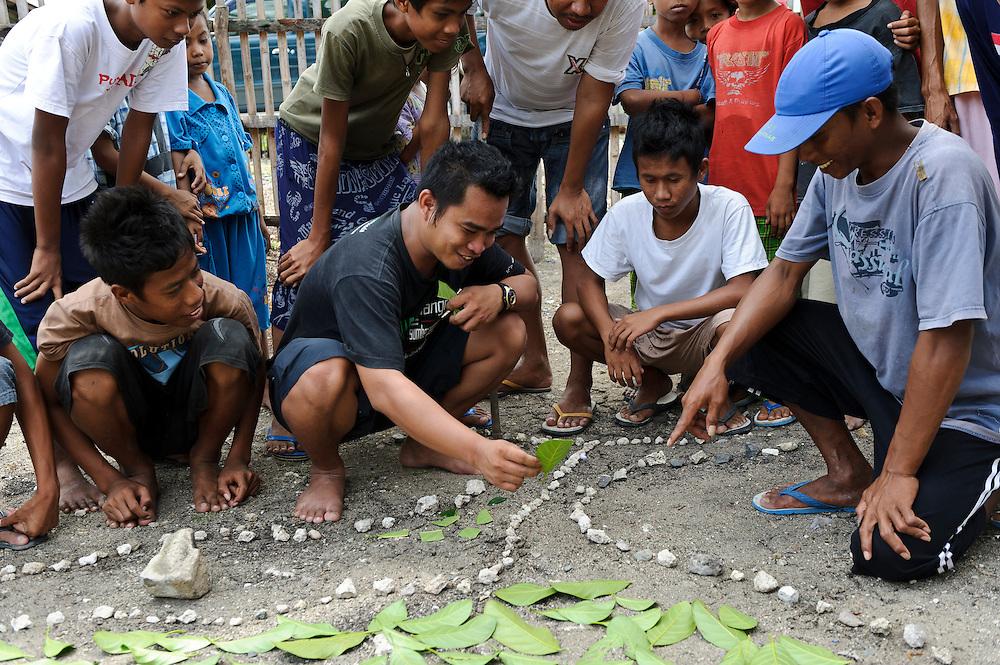 Jacob Botutihe (JAPESDA) with village members during a participatory RPMJDes, Bangga, Gorontalo, Sulawesi, Indonesia.