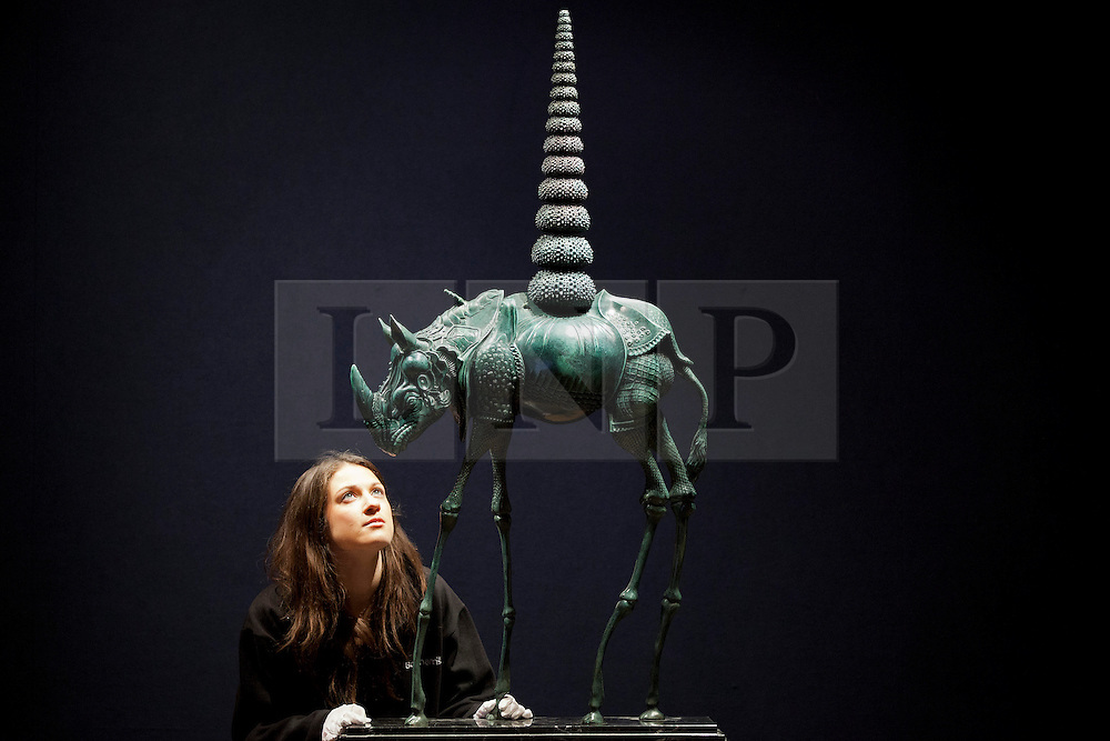 © Licensed to London News Pictures. 31/01/2013. London, UK. A Bonhams employee views 'Chair de poule rhinocerontique, ou Rhinoceros cosmique' (conceived in 1956) (est. GB£150,000-250,000) a bronze sculpture by Spanish surrealist Salvador Dali at the press view for the Bonhams' Impressionist and Modern Art Sale in London today (31/01/13). The sale, to be held at the London based auction house's New Oxford Street premises on the 5th of February, features a selection of eclectic artists including Camille Pissarro, Fernand Leger and Edgar Degas. Photo credit: Matt Cetti-Roberts/LNP