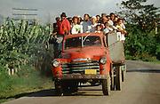 CUBA, SANTIAGO DE CUBA..Public transport with pre-revolutionary (1959) vintage Chevrolet truck..(Photo by Heimo Aga)
