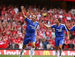 CARDIFF, WALES - SUNDAY, AUGUST 13th, 2006: Chelsea's Andriy Shevchenko celebrates scoring the equalizer against Liverpool, with his team-mate Frank Lampard, during the Community Shield match at the Millennium Stadium. (Pic by David Rawcliffe/Propaganda)