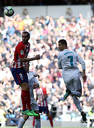 April 8, 2018 - Madrid, Madrid, Spain - Cristiano Ronaldo (Real Madrid) competes for the ball with Godin (Club Atletico de Madrid) during the La Liga match between Real Madrid and Atletico de Madrid FC at Estadio Santiago Bernabeu. (Credit Image: © Manu Reino/SOPA Images via ZUMA Wire)