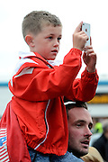 Walsall fan taking a picture of the Chelsea team during the Capital One Cup match between Walsall and Chelsea at the Banks's Stadium, Walsall, England on 23 September 2015. Photo by Alan Franklin.
