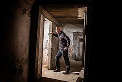 © Licensed to London News Pictures. 23/06/2015. Leeds, UK. Rarely seen hidden Tudor tunnels & cellars of Temple Newsam house in Yorkshire. Picture shows a member of staff standing in one of the hidden cellars. Temple Newsam is famous as the birth place of Lord Darnley, notorious husband of Mary Queen of Scots. The Tudor-Jacobean mansion is set in 1,500 acres with grounds landscaped by Capability Brown. Photo credit : Andrew McCaren/LNP