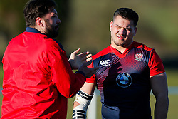 Former England International Alex Corbisiero (L) gives advice to England U20 prop Lewis Boyce (Yorkshire Carnegie) as he takes training in his new role as a part time positional coach - Mandatory byline: Rogan Thomson/JMP - 08/03/2016 - RUGBY UNION - Clifton Rugby Club - Bristol, England - England Under 20s Training at Bristol Rugby.