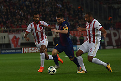 October 31, 2017 - Piraeus, Attica, Greece - Lionel Messi (C) of Barcelona vies for the ball with Olympiakos' Belgian midfielder Vadis Odjida (R) and Olympiakos' French-Togolese midfielder Alaixys Romao (L) during the UEFA Champions League group D football match between FC Barcelona and Olympiakos FC at the Karaiskakis stadium in Piraeus near Athens on October 31, 2017. (Credit Image: © Wassilios Aswestopoulos/NurPhoto via ZUMA Press)