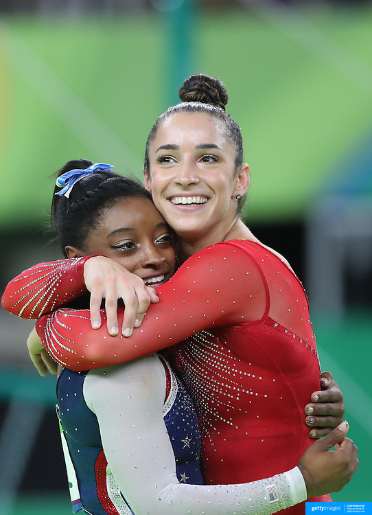 Gymnastics - Olympics: Day 6  Simone Biles of the United State and Alexandra Raisman of the United States embrace as the final result come through confirm Gold and Silver for the pair during the Artistic Gymnastics Women's Individual All-Around Final at the Rio Olympic Arena on August 11, 2016 in Rio de Janeiro, Brazil. (Photo by Tim Clayton/Corbis via Getty Images)