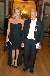 DONALD KAHN and EVA MARIA O'NEILL at The Royal Academy dinner before the official opening of the Summer Exhibition held at the Royal Academy of Art, Burlington House, Piccadilly, London W1 on 6th June 2006.<br />