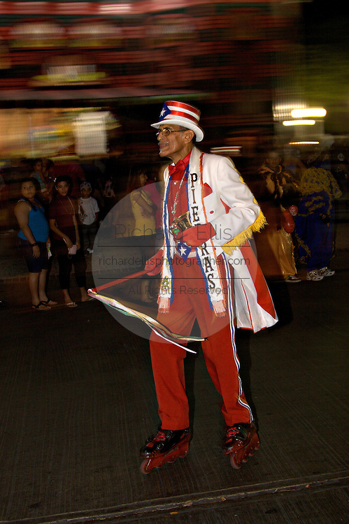 A costumed man with roller blades dances in the streets during the Carnaval de Ponce February 21, 2009 in Ponce, Puerto Rico.