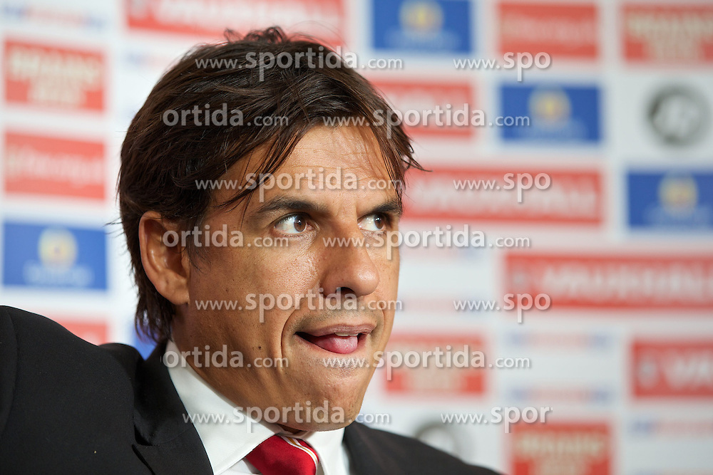 28.08.2013, Parc y Scarlets, Llanelli, WAL, FIFA WM Qualifikation, Pressekonferenz, im Bild Wales' manager Chris Coleman at a press conference to announce his squad for the games against Serbia and Macedonia at Parc-y-Scarlets. during a pressconference of English Footballteam at Parc y Scarlets, Llanelli, Wales on 2013/08/28. EXPA Pictures &copy; 2013, PhotoCredit: EXPA/ Propagandaphoto/ David Rawcliffe<br /> <br /> ***** ATTENTION - OUT OF ENG, GBR, UK *****