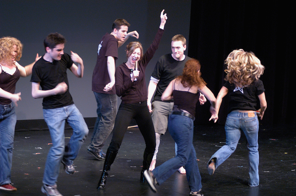 "Jessie (Valerie Clift) and John Walker (Brian Charles Rooney) and the Patriot Chorus (Sarah Vidal, Josh Fiedler, Brian Reilly, Amy McKee, Ginger Kroll) in a scene from ""John Walker: The Musical"" at the 2004 New York International Fringe Festival"