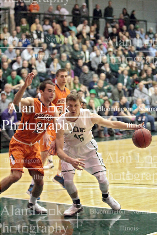 01 March 2014:  Michael Mayberger works the paint against Peter Smith during an NCAA mens division 3 CCIW  Championship basketball game between the Wheaton Thunder and the Illinois Wesleyan Titans in Shirk Center, Bloomington IL