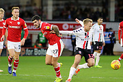 Barnsley midfielder Alex Mowatt (27) and Charlton Athletic midfielder Ben Reeves (12) lock arms during the EFL Sky Bet League 1 match between Barnsley and Charlton Athletic at Oakwell, Barnsley, England on 29 December 2018.
