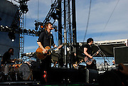 Patrick Keeler, Brendan Benson, Jack Lawrence, and Jack White performing with the Raconteurs at the Vegoose Music Festival in Las Vegas Nevada, October 28, 2006.