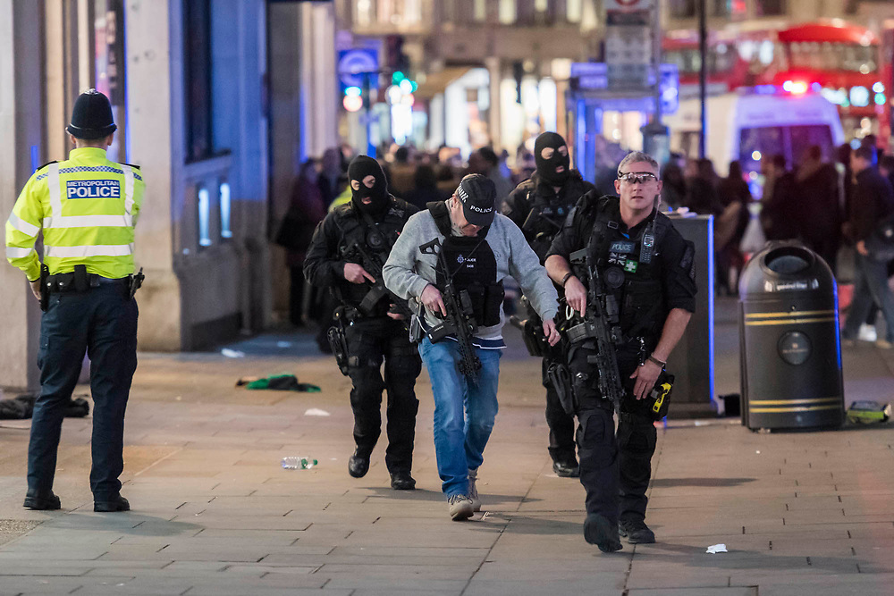 Armed police, some masked arrive on teh scene - Armed police flood the Oxford Circus area after an incident caused the station to be cleared.