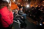 Boston, MA 12/09/2011.Occupy Boston protestors Patrick, right, and Chris sit outside their tent in the middle of Atlantic Avenue early Friday morning..Alex Jones / www.alexjonesphoto.com