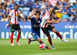 Shinji Okazaki of Leicester City (L) and Younes Kaboul of Sunderland in action  - Mandatory byline: Jack Phillips/JMP - 07966386802 - 08/08/2015 - SPORT - FOOTBALL - Leicester - King Power Stadium - Leicester City v Sunderland - Barclays Premier League