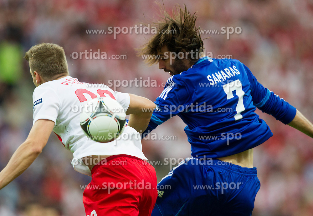 Lukasz Piszczek of Poland vs Giorgos Samaras  of Greece prior to the UEFA EURO 2012 group A match between Poland and Greece at The National Stadium on June 8, 2012 in Warsaw, Poland.  (Photo by Vid Ponikvar / Sportida.com)