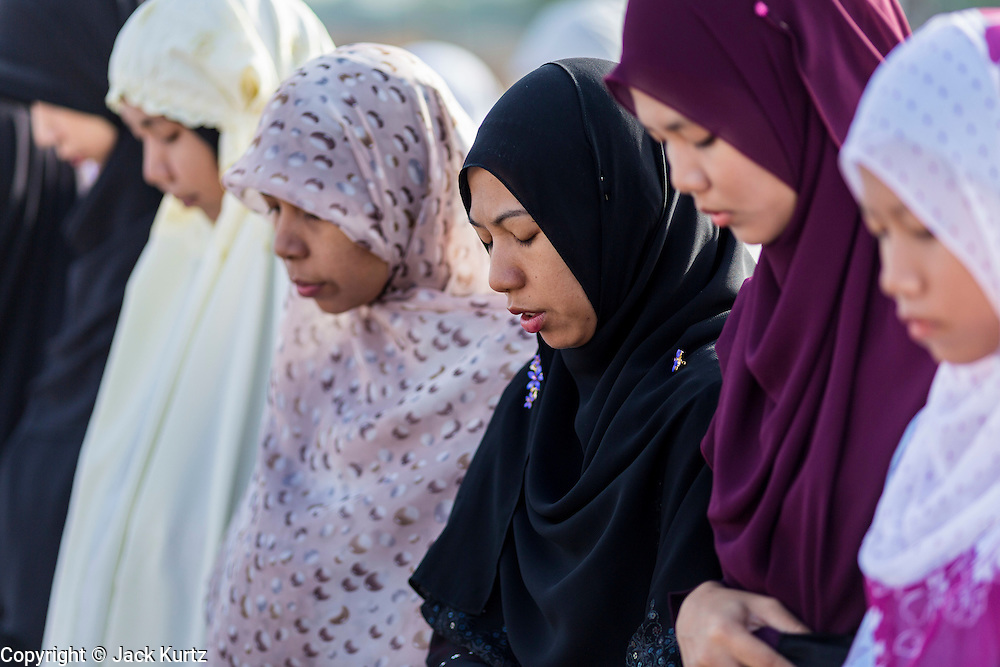 Women pray during Eid services at Songkhla Central Mosque in Songkhla province of Thailand. Eid al-Fitr is also called Feast of Breaking the Fast, the Sugar Feast, Bayram (Bajram), the Sweet Festival and the Lesser Eid, is an important Muslim holiday that marks the end of Ramadan, the Islamic holy month of fasting.