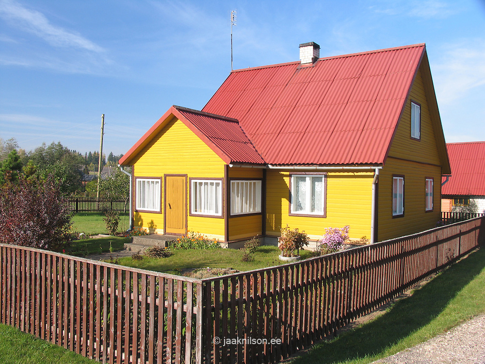 Typical Estonian Yellow Wooden House in Võru County, Estonia
