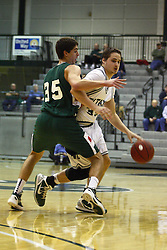 17 December 2011:  Andrew Ziemnik dribbles guarded by Matt Palucki during an NCAA mens division 3 basketball game between the Washington University Bears and the Illinois Wesleyan Titans in Shirk Center, Bloomington IL