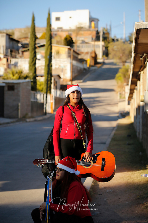 """Carla Chavez of Tucson, Ariz., takes part in a bi-national """"posada"""" Dec. 20 in Nogales, Sonora. People from the U.S. and Mexico gathered near the international border for the commemoration of Mary and Joseph's search for shelter before the birth of Christ. (CNS photo/Nancy Wiechec)"""