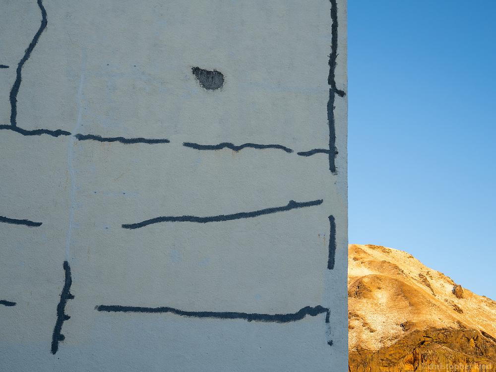 Repaired wall in Vestmannaeyjar islands, Iceland.