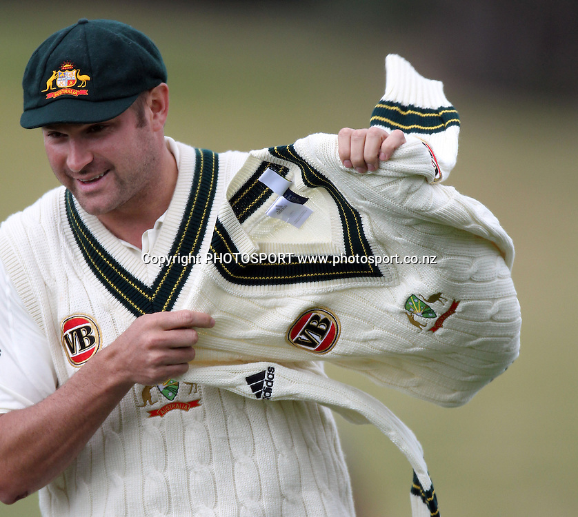 Australian bowler Ryan Harris grabs another jersey.<br />