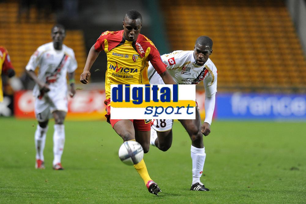 FOOTBALL - FRENCH CHAMPIONSHIP 2010/2011 - L1 - RC LENS v OGC NICE - 23/10/2010 - PHOTO JEAN MARIE HERVIO / DPPI - ABDOULRAZAK BOUKARI (RCL) / ISMAEL GACE (OGCN)