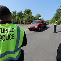 Tupelo Police Officers check for driver license's and properly tags during a safety checkpoint on Lumpkin Street.