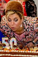LELYSTAD -Koningin maxima with birthday cake that says 50-year- King William Alexander celebrates 50th birthday this week Queen Maxima opened the 50th Resto VanHarte in Lelystad on Thursday. Children aged 8 to 13 can cook together in this children's restaurant in Zuiderzee district center, learn about nutrition and moving. VanHarte wants to connect with the restaurants with the neighborhood and get people out of social isolation. Besides activities, affordable three-course dinners are also served. M&aacute;xima opened the restaurant together with nearby children. State Secretary Jetta Klijnsma, Mayor Ina Adema and Commissioner of the King Leen Verbeek were also included. COPYRIGHT ROBIN UTRECHT<br /> LELYSTAD -koningin maxima met een taart met 50 jaar erop koning willem-alexander wordt deze week 50 jaar verjaardag vieren  Koningin Maxima heeft donderdag de 50e Resto VanHarte geopend in Lelystad. Kinderen van 8 tot en met 13 jaar kunnen in dit kinderrestaurant in Wijkcentrum Zuiderzee samen koken, leren over voeding en bewegen. VanHarte wil met de restaurants verbinding cre&euml;ren met de buurt en mensen uit een sociaal isolement halen. Er worden naast activiteiten ook betaalbare driegangendiners geserveerd.M&aacute;xima opende het restaurant samen met kinderen uit de buurt. Staatssecretaris Jetta Klijnsma, burgemeester Ina Adema en Commissaris van de Koning Leen Verbeek waren er ook bij. COPYRIGHT ROBIN UTRECHT