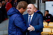 Accrington Stanley Manager John Coleman and Wimbledon Manager Neal Ardley shake during the EFL Sky Bet League 1 match between Accrington Stanley and AFC Wimbledon at the Fraser Eagle Stadium, Accrington, England on 22 September 2018.