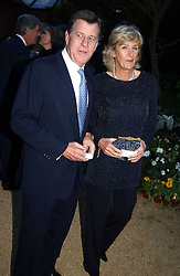 SIMON & ANNABEL ELLIOT she is the sister of HRH the Duchess of Cornwall at the Cartier Chelsea Flower Show dinat the annual Cartier Flower Show Diner held at The Physics Garden, Chelsea, London on 23rd May 2005.<br />