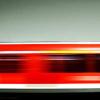 Motion stripes of a passing red train. German railroad.