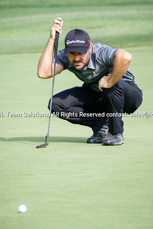 28 MAY 2015: Trevor Immelman lines up his putt on #17 during the first round of the AT&T Byron Nelson Championship in Irving, TX.