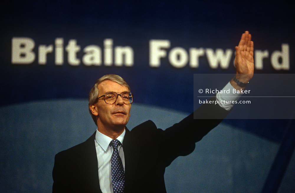 British Prime Minister, John Major acknowledges supporters during a Conservative party election rally on 18th March 1992, in Brighton, England. Major went on to win the election weeks later and was the fourth consecutive victory for the Conservative Party although it was its last outright win until 2015 after Labour's 1997 win for Tony Blair.
