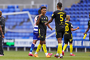 Brentford forward Ollie Watkins (11) and Brentford defender Ethan Pinnock (5) congratulate each other at full time during the EFL Sky Bet Championship match between Reading and Brentford at the Madejski Stadium, Reading, England on 30 June 2020.