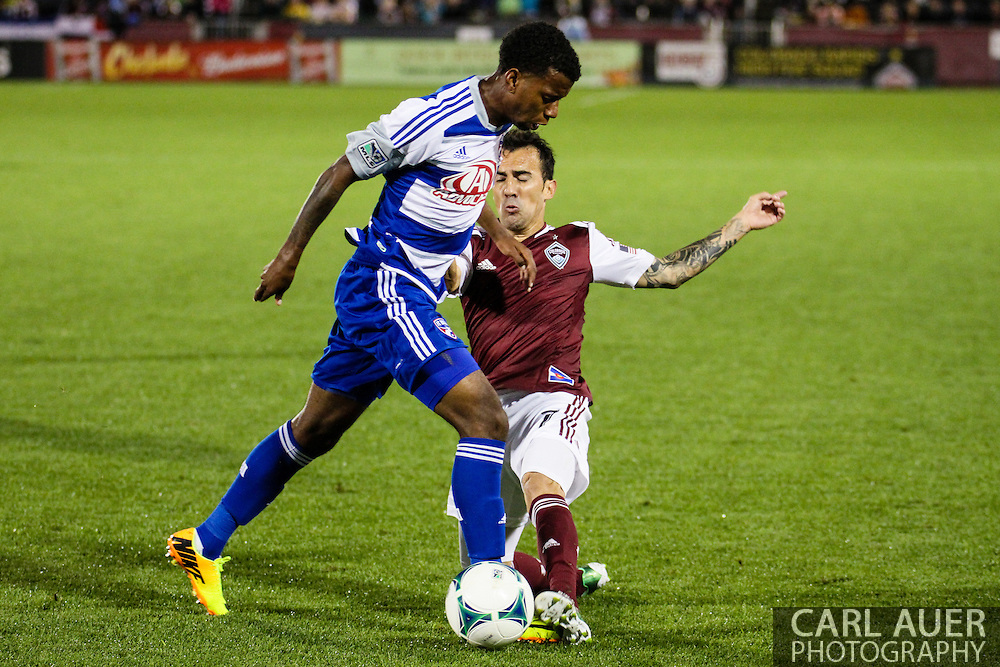 September 14th, 2013 -  FC Dallas midfielder Kellyn Acosta (23) attempts to get the ball past Colorado Rapids forward Vicente Sánchez (7) in first half action of the MLS Soccer game between FC Dallas and the Colorado Rapids at Dick's Sporting Goods Park in Commerce City, CO
