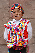Quechua boy wearing traditional clothing of the region; Moray Village, Sacred Valley, Peru.