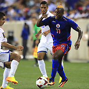 Jean-Eude Maurice, Haiti, (right), takes on Jorge Aaron Claros, Honduras, during the Haiti V Honduras CONCACAF Gold Cup group B football match at Red Bull Arena, Harrison, New Jersey. USA. 8th July 2013. Photo Tim Clayton