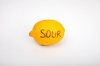 Sour lemon over white background