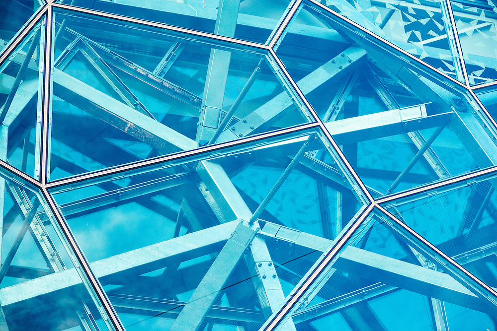 The steel and glass panels of a building in Federation Square, Melbourne.