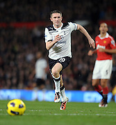 Robbie Keane in action during the Barclays Premier League match between Manchester United and Tottenham Hotspur at Old Trafford on October 30, 2010 in Manchester, England.