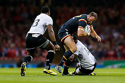 Wales Inside Centre Jamie Roberts is tackled by Fiji Inside Centre Lepani Botia - Mandatory byline: Rogan Thomson/JMP - 07966 386802 - 01/10/2015 - RUGBY UNION - Millennium Stadium - Cardiff, Wales - Wales v Fiji - Rugby World Cup 2015 Pool A.