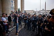 Roma, 12 Maggio 2014<br /> Manifestazione dei Movimenti per il diritto all'abitare hanno contestato il Presidente del Consiglio Matteo Renzi che parlava sul palco di piazza del Popolo per la manifestazione conclusiva del Partito Democratico in vista delle elezioni europee di domenica. Attivisti dei Movimenti per la Casa sono stati fermati dalla Polizia. Nella foto, manifestante fermato dalla polizia<br /> Rome, May 12, 2014 <br /> Manifestation of the movements for housing rights, objected to the Chairman of the Board, Matteo Renzi, who spoke on stage at the Piazza del Popolo to the closing event of the Democratic Party in the European elections on Sunday. Activists of the Movement for the House were stopped by the police. In the picture the protester stopped by the police