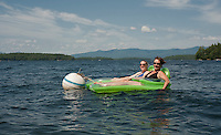 """""""No Place That I'd Rather Be""""...   for Cathy Cram and her niece visiting from Massachusetts as they enjoy lounging in Lake Winnipesaukee on Friday afternoon.  (Karen Bobotas/for the Laconia Daily Sun)"""