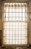 A window in Alcatraz Prison, a National Historical Landmark in San Fransisco Bay, California, USA.
